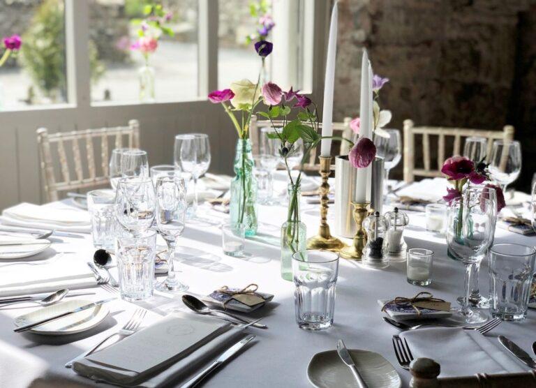 table setup with wedding flowers